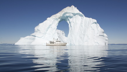 The Bagan in front of an iceberg at Disko Bay, North Greenland. HITW PRODUCTIONS
