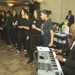 The Renaissance EMS Chorus at keyboard Beervine Harris (Executive Director)