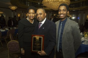 (Center) Penda C. Howell (Press Service Excellence in Media Honoree) with his wife and son