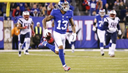 New York Giants wide receiver Odell Beckham (13) runs away from New England Patriots' Malcom Brown (90) and Rob Ninkovich (50) for a touchdown during the first half of an NFL football game, Sunday Nov. 15, 2015, in East Rutherford, N.J. (AP Photo/Julio Cortez) ORG XMIT: ERU109
